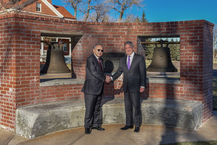 Jose Romualdez, Philippine Ambassador to the United States, and Defense Secretary James N. Mattis, stand for a photo, November 14, 2018, in front of the bells of Balangiga on F.E. Warren Air Force Base, Wyoming (U.S. Air Force photo by Airman 1st Class Braydon Williams, image via F.E. Warren Air Force Base)
