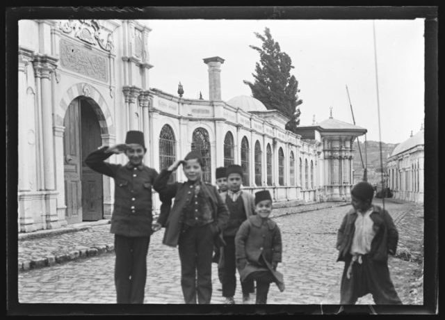 Boys standing in the street (c. 1900), glass plate negative