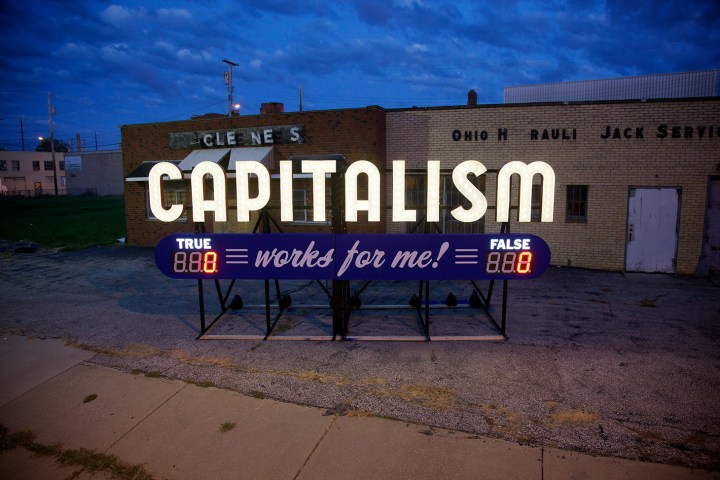 "Steve Lambert, ""Capitalism Works For Me! True/False,"" aluminum and electrical, 9 x 20 x 7 feet (image courtesy the artist)"