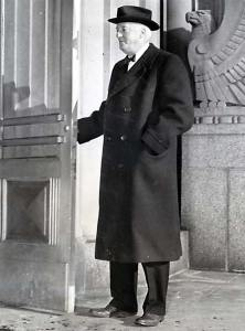 """Cutline on the press photo dated 3-5-42 showing Egan with a federal eagle behind him, posed as if to sink his claws into him:  """"Louis H. Egan, former president of the Union Electric Company of Missouri entering federal court in St. Louis, Mo., where he was found guilty of violating the Corrupt Practices section of the Utility Act. """""""