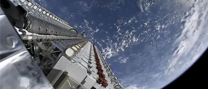 More than 60 Starlink satellites orbiting earth before deployment.