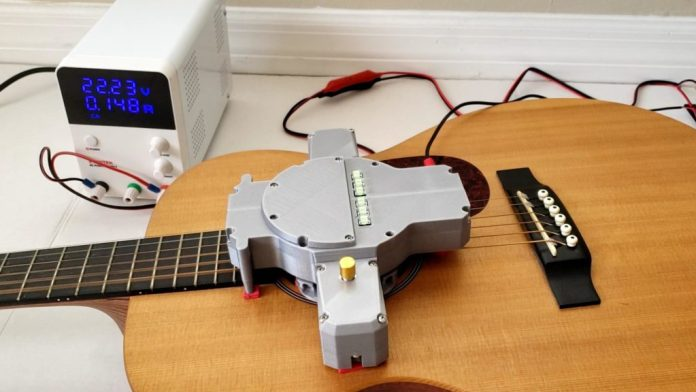 autostrummer is a diy device that strums your guitar for you hyperedge embed image