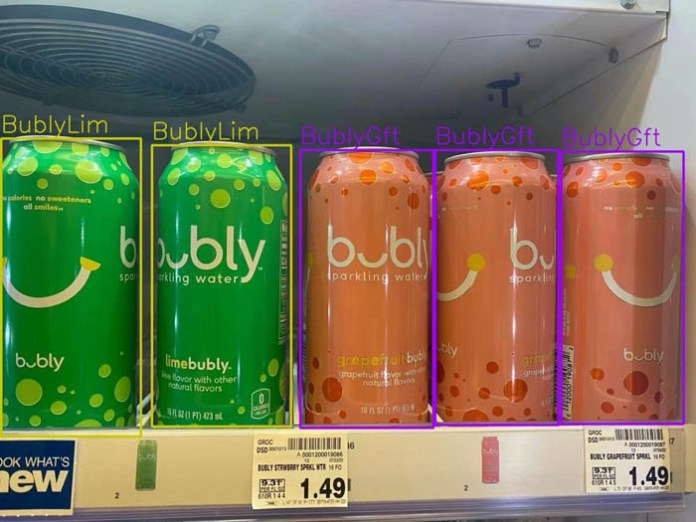 The image shows a vertical refrigerator shelf with 2 BublyLim green cans and 3 BublyGft orange cans.