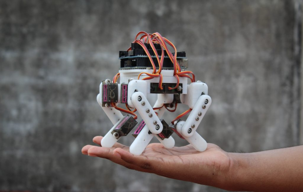 an arduino powered micro quadruped that fits in the palm of your hand hyperedge embed image