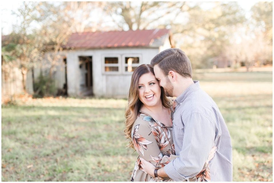 engagement session at a barn during sunset golden hour