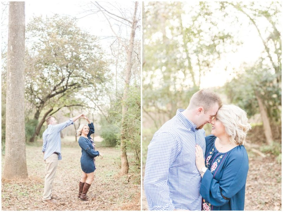 engaged couple posing in the woods, twirling