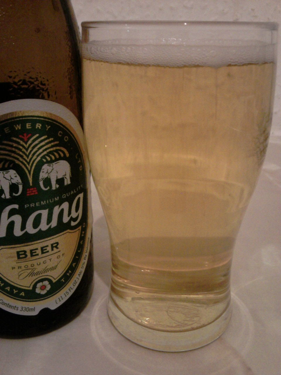 Chang Beer poured into a glass