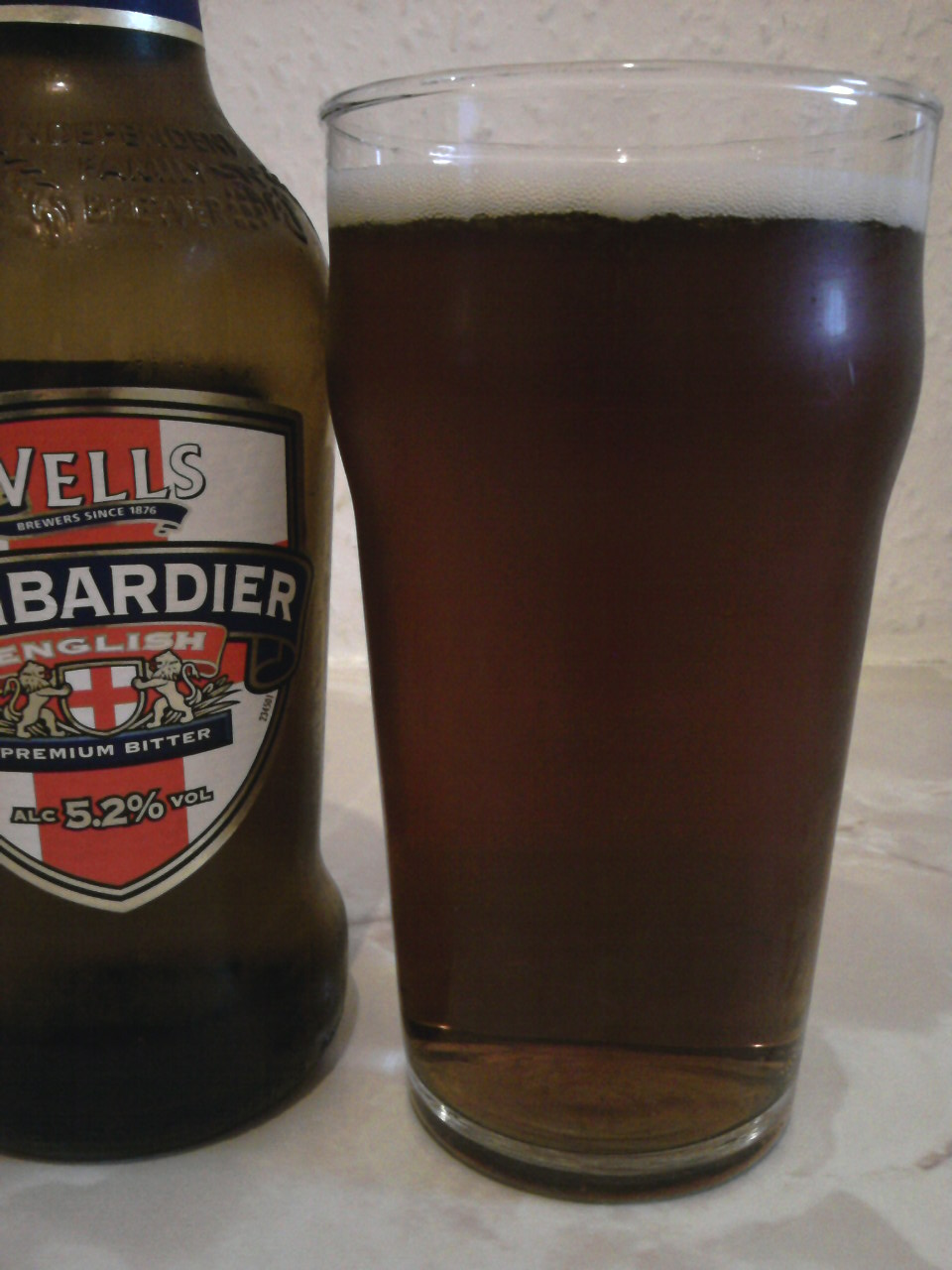 Wells Bombardier English Premium Bitter poured into a glass