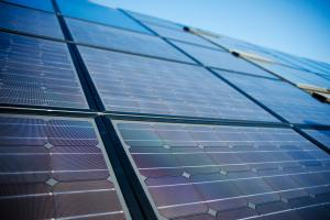 Low angle view of solar panels against sky