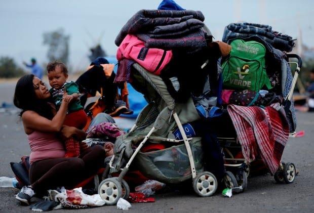 IMMIGRATION CARAVAN migrant from Hondruas comforts baby