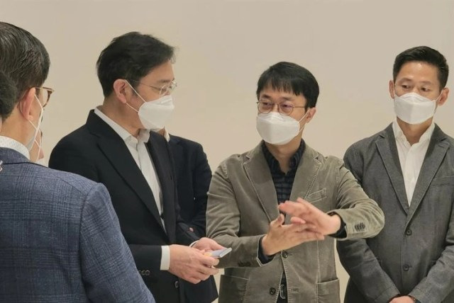 Samsung's Vice Chairman Lee Jae-yong seen with a device presumed to be its rollable prototype - Samsung may have just teased its rollable phone