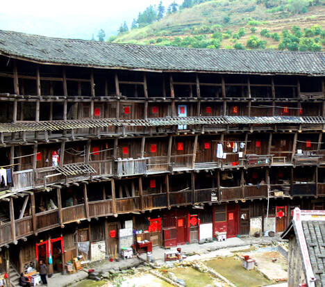 tulou concealed ancient chinese fortress Yuchang lou: interior view. Partly demolished rings in the middle