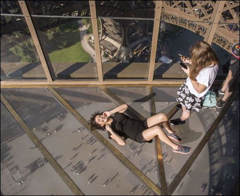 Eiffel Tower Fancy Glass Floor Young tourists enjoy the new glas Floor at level 1 of the Eiffel Tower