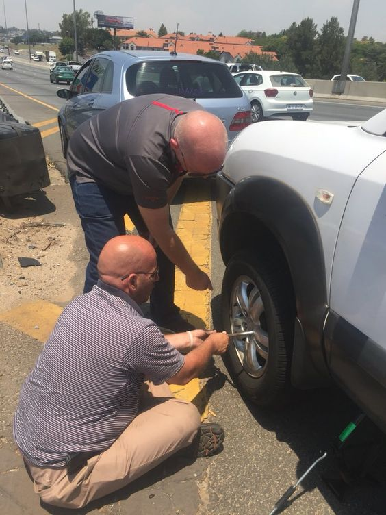 My car experienced a flat tyre on the highway. Everyone just drove on by, minding their own. I was on the phone with my insurance company when these two gents stopped and offered assistance. Thank you Shaun and Gabriel. Your kindness is much appreciated. #RandomActOfKindnesspic.twitter.com/NhFSWwYZhi