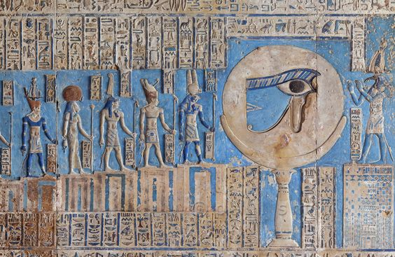 "[EGYPT 29567]<br /> 'The waxing moon and the Eye of Horus at Dendera.'<br /> <br /> 	This forceful image of the moon on a pillar, decorated with the ""healed eye"" of Horus, can be found on the astronomical ceiling of the outer hypostyle hall in the Hathor Temple at Dendera.<br /> The astronomical ceiling consists of seven separate strips but here we are looking at a detail of the FIRST STRIP WEST from centre.<br /> The deities in this picture form part of a panel that deals with the waxing moo..."
