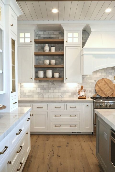 Beautiful Kitchen with White Cabinets and Marble. Silverhawk Enterprises.