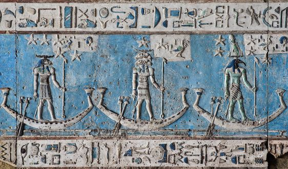 [EGYPT 29538] 'Decanal stars on boats in Hathor Temple at Dendera.'  	Starry gods are sailing on boats across the firmament on the astronomical ceiling in the outer hypostyle hall of the Hathor Temple at Dendera. The ceiling consists of seven separate strips but here we are looking at a detail of the lower register of the EASTERNMOST STRIP. The ram-headed god, the god with four ram heads and the ibis-headed god are the decanal stars 25, 24 and 23. In fact, the lower register of the east...