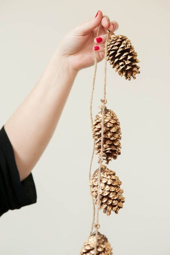 golden pine cone garland diy for friendsgiving decor