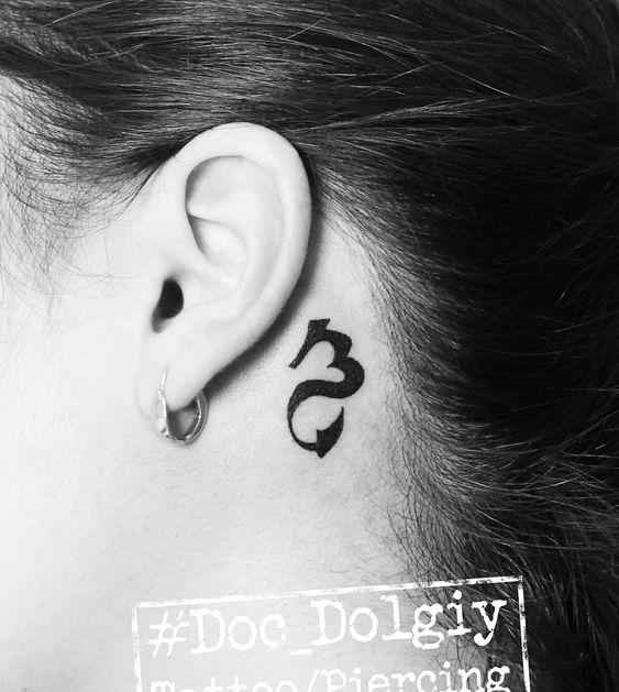 A symbolic ear-back tattoo- 27 Low-key Gorgeous Scorpio Tattoos