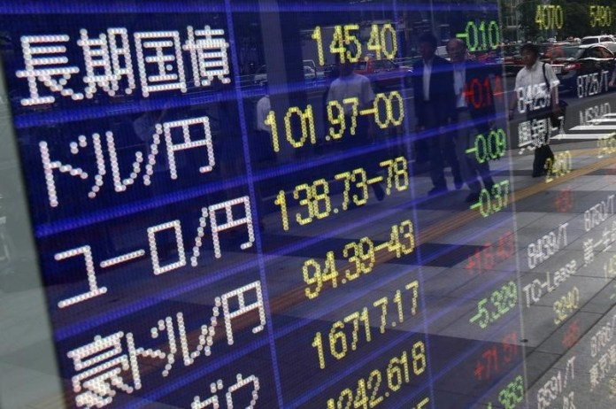© Reuters. Asian markets clawed back some of their earlier losses in afternoon trade
