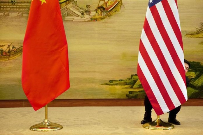 © -.  China Waits for U.S. to Make Next Move, Days After Trump Says He's in No Rush