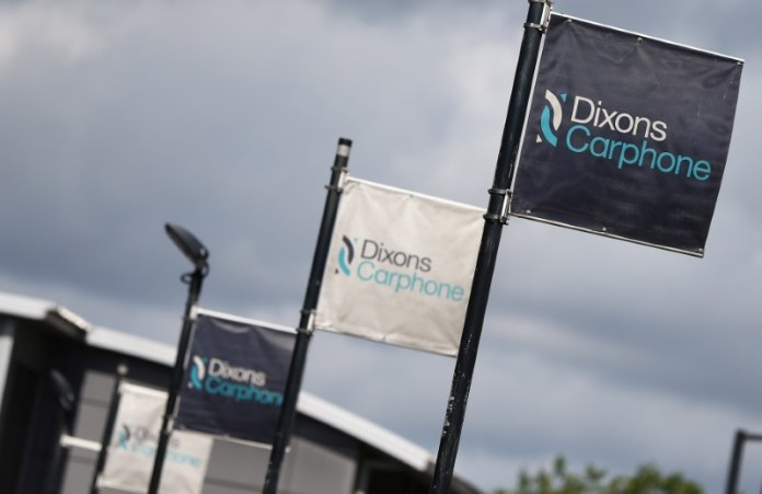© Reuters. Signs display the logo of Dixons Carphone at the company headquarters in London