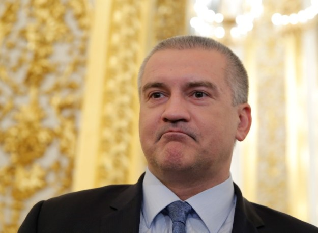 © Reuters. Head of Crimea Aksyonov waits before annual state of nation address attended by Russian President Putin at Kremlin in Moscow