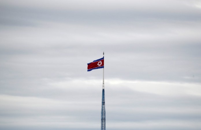 © Reuters. A North Korean flag flutters on top of a 160-metre tower in North Korea's propaganda village of Gijungdong, in this picture taken from the Tae Sung freedom village near the Military Demarcation Line (MDL), in Paju