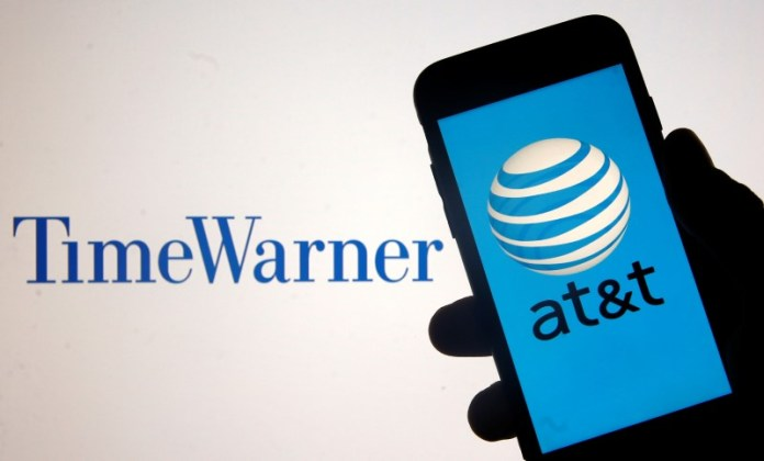 © Reuters. Smartphone with AT&T logo is seen in front of displayed Time Warner logo in this picture illustration