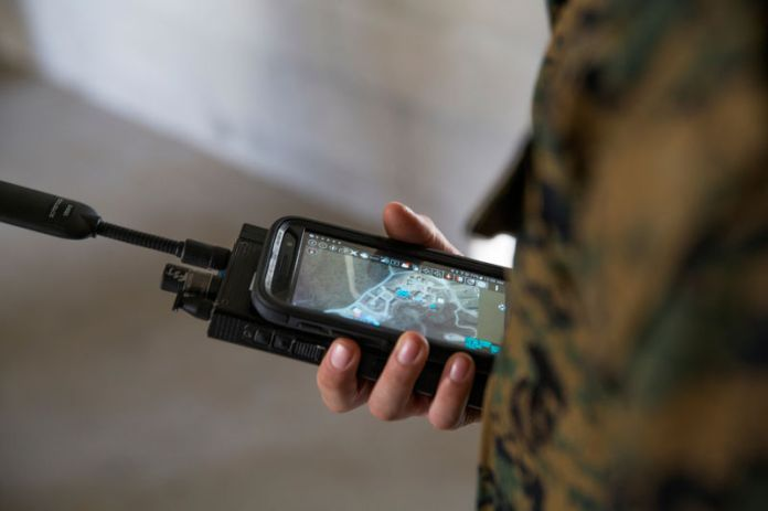 © Reuters. FILE PHOTO: A U.S. Marine is assessed utilizing a communications radio with real time on screen GPS location at Camp Pendleton