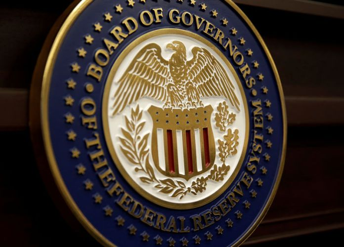 © Reuters. FILE PHOTO: The seal for the Board of Governors of the Federal Reserve System is displayed in Washington