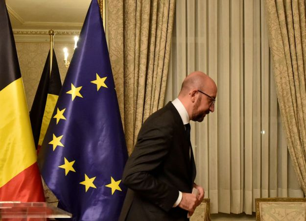 © Reuters. FILE PHOTO: Belgium's Prime Minister Charles Michel leaves after a news conference in Brussels
