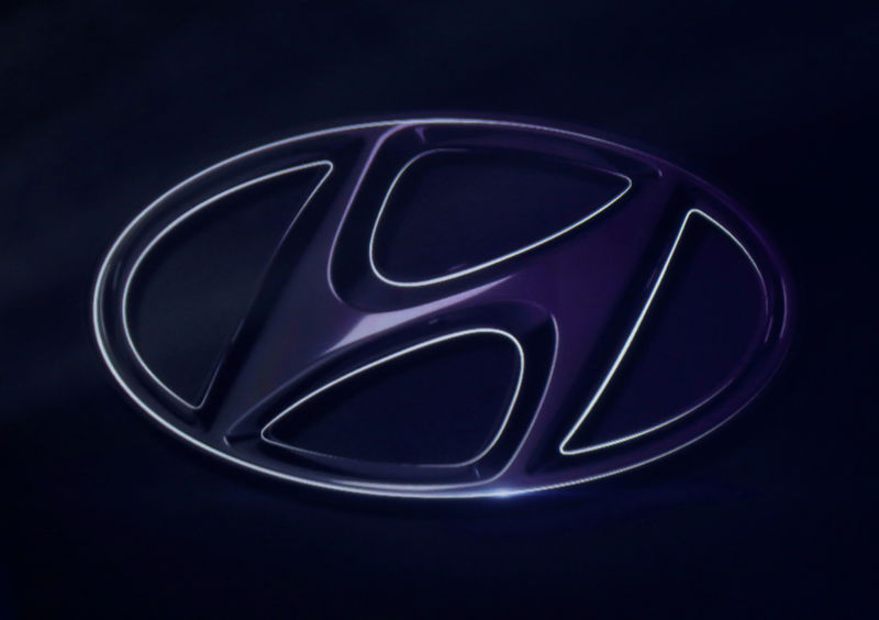 © Reuters. FILE PHOTO: The logo of Hyundai Motor is seen on wall at a event of Hyundai Motor Co's new Accent in Mexico City