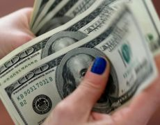 Dollar consolidates gains amid cautious optimism on tariff deal By Reuters