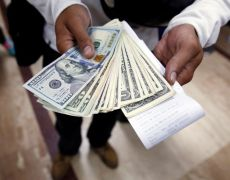 Dollar heads for weekly decline as data and trade tensions weigh By Reuters