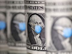 Dollar nurses losses after Fed, jump in risk appetite By Reuters