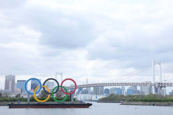 Japan denies report of vaccine priority for Olympic athletes after outcry