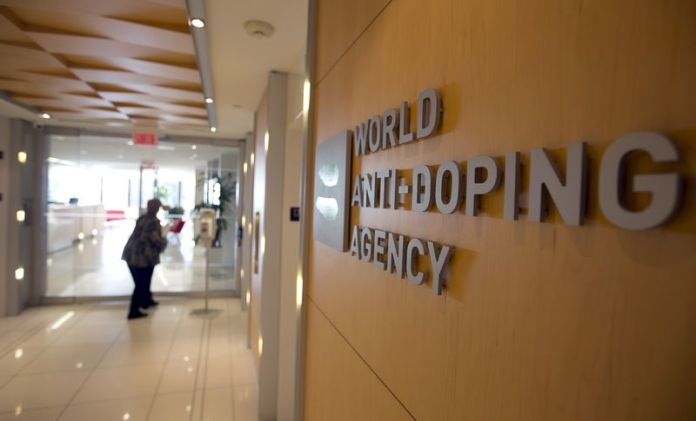 © Reuters. FILE PHOTO - A woman walks into the head offices for WADA in Montreal