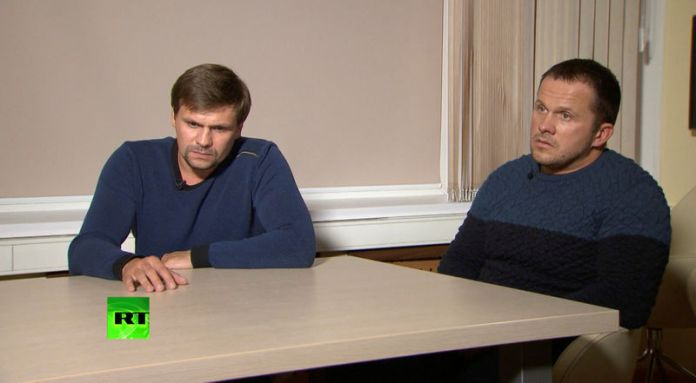 © Reuters. A still image shows two Russian men with the same names as those accused by Britain over Skripal case during an interview at an unidentified location