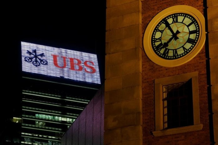 © Reuters. A UBS advertisement is displayed on top of a commercial building in Hong Kong