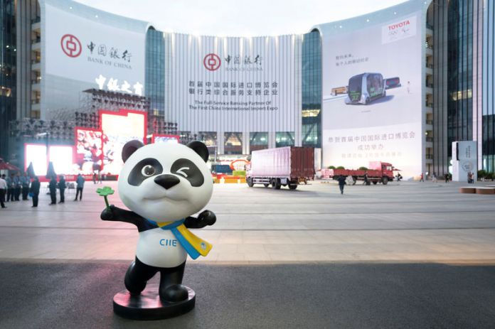 © Reuters. Statue of the China International Import Expo (CIIE)'s mascot is placed in front of a building hanging advertisement of Bank of China, at the venue for the expo in Shanghai