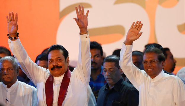 © Reuters. FILE PHOTO: Sri Lanka's newly appointed Prime Minister Rajapaksa and President Sirisena wave at their supporters during a rally near the parliament in Colombo