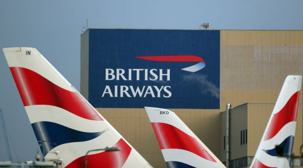 © Reuters. British Airways logos are seen on tail fins at Heathrow Airport in west London
