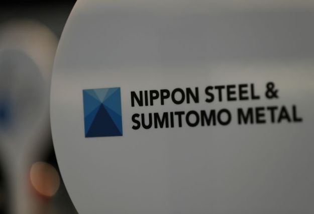 © Reuters. The logo of Nippon Steel & Sumitomo Metal Corp.'s Kimitsu steel plant is pictured at its exhibition hall in Kimitsu