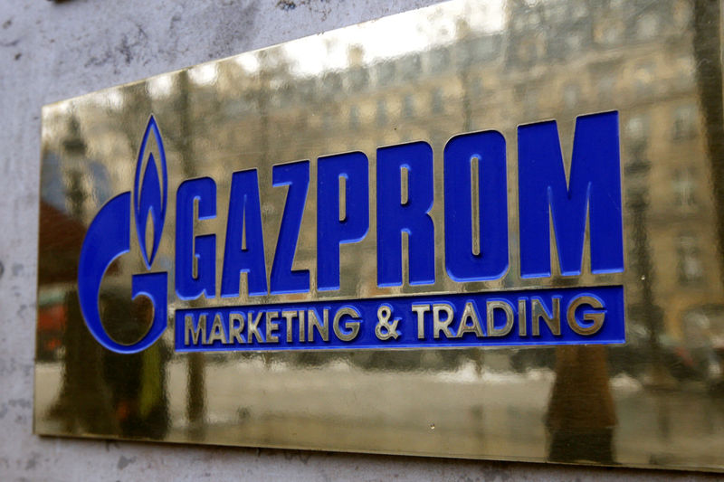 © Reuters. FILE PHOTO: The logo of Gazprom marketing department is seen in front of the office located on the Champs Elysees in Paris