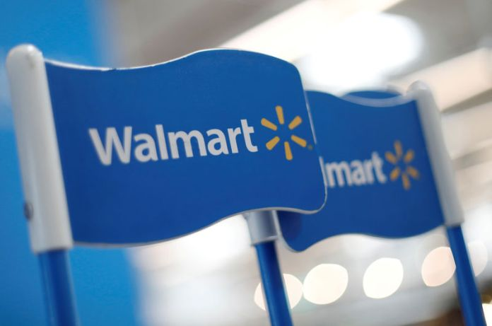 © Reuters. FILE PHOTO: Walmart signs are displayed inside a Walmart store in Mexico City