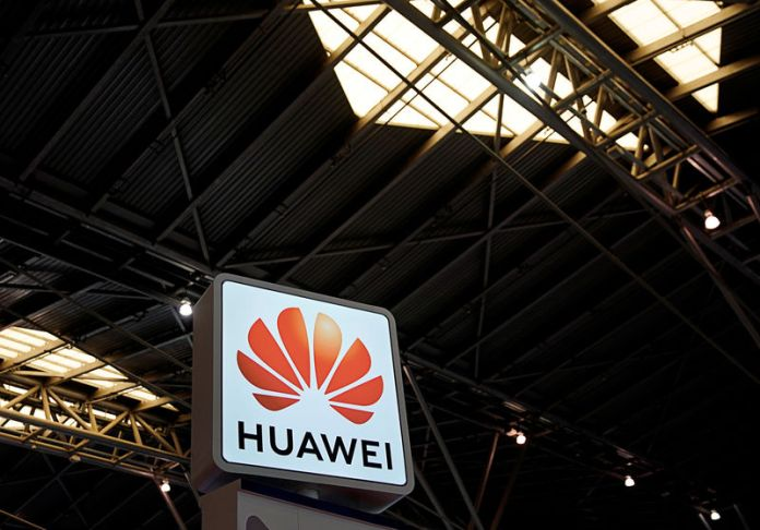 © -. A Huawei company logo is seen at the security exhibition in Shanghai