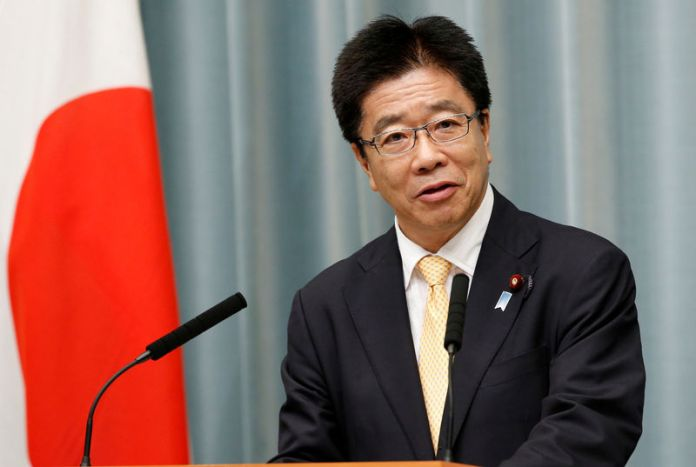 © -. FILE PHOTO: Japan's Health, Labour and Welfare Minister Katsunobu Kato speaks at a news conference in Tokyo