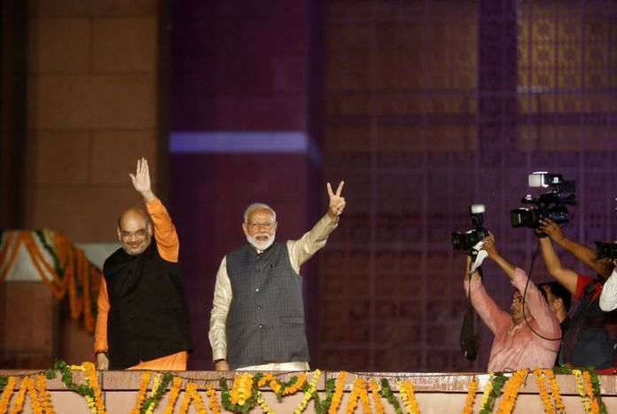 © -. BJP President Amit Shah and Indian Prime Minister Narendra Modi gesture after the election results in New Delhi