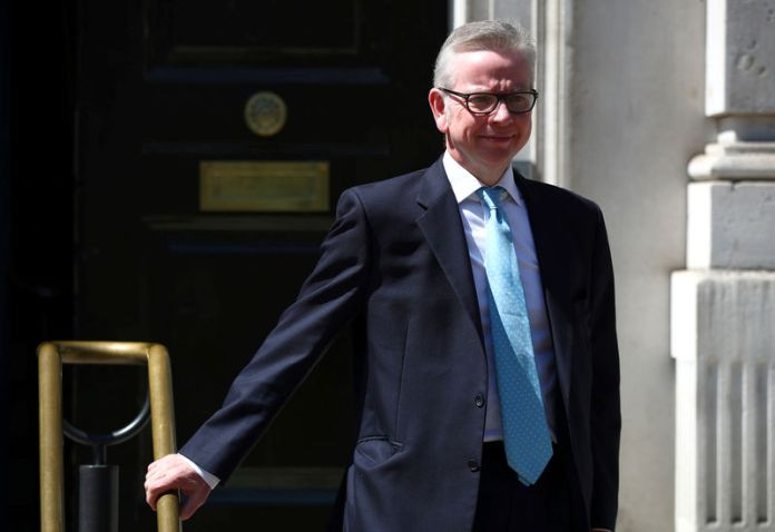 © -. Britain's Secretary of State for Environment, Food and Rural Affairs Michael Gove is seen outside the Cabinet Office in London